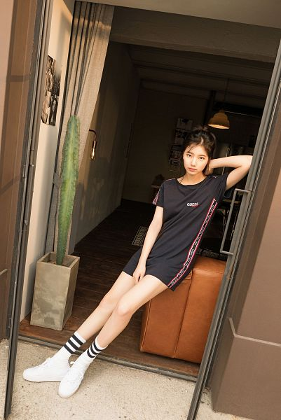 Tags: K-Pop, Bae Suzy, Window, Cactus, Black Dress, Serious, Single Bun, Black Outfit, White Footwear, Short Sleeves, Hair Buns, Plant