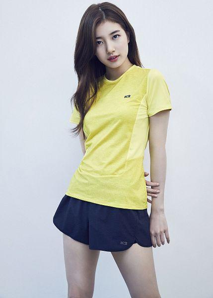 Tags: K-Pop, Bae Suzy, White Background, Short Sleeves, Shorts, Serious, Black Eyes, Blue Shorts, Yellow Shirt, Light Background, K2