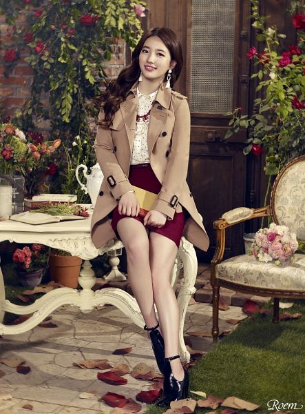 Tags: K-Pop, Miss A, Bae Suzy, Sitting On Table, Skirt, Book, Red Skirt, Brown Outerwear, Flower, Grin, Table, Coat