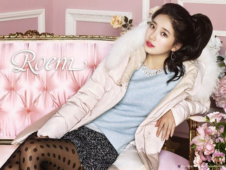 Tags: K-Pop, Miss A, Bae Suzy, Necklace, Sitting On Couch, Fur Trim, Couch, Make Up, Black Skirt, Brown Legwear, Skirt, Pink Flower