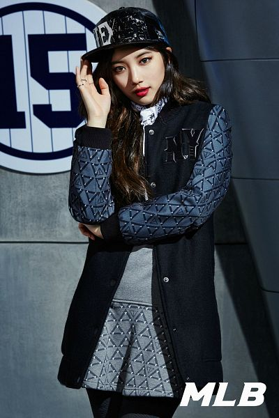 Tags: K-Pop, Miss A, Bae Suzy, Text: Brand Name, Gray Background, Black Jacket, Gray Shirt, Black Outerwear, Ring, Black Legwear, Pleated Skirt, Hat