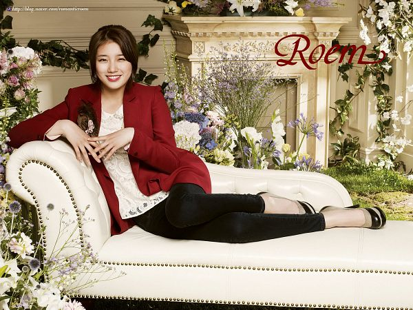 Tags: K-Pop, Miss A, Bae Suzy, Grin, Couch, Text: Brand Name, Lace, Red Jacket, Sitting On Couch, Fireplace, Black Pants, Red Outerwear