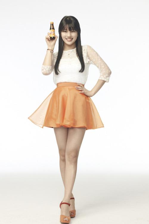 Tags: K-Pop, Miss A, Bae Suzy, Orange Skirt, Skirt, Light Background, White Background, Black Eyes, Grin, Crossed Legs (Standing), Hand On Hip, Bottle