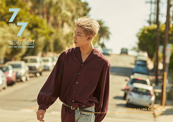 Tags: K-Pop, Got7, BamBam, Text: Album Name, Red Shirt, Looking Away, Plant, Text: Calendar Date, Road, Walking, Text: Artist Name, Belt