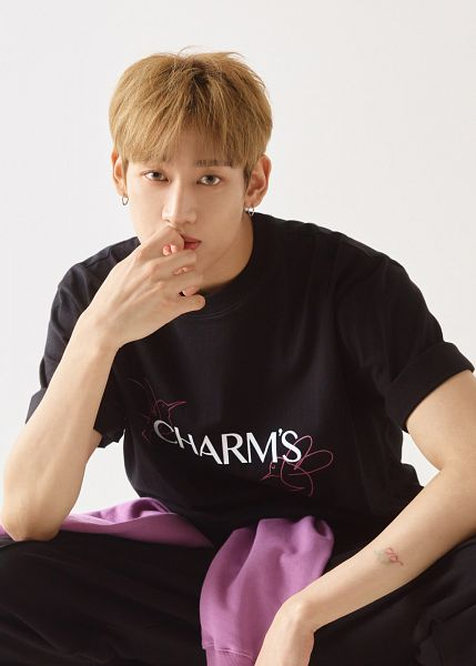 Tags: K-Pop, Got7, BamBam, Tattoo, Black Pants, Light Background, White Background, Serious, Short Sleeves, Crouching, Charm's