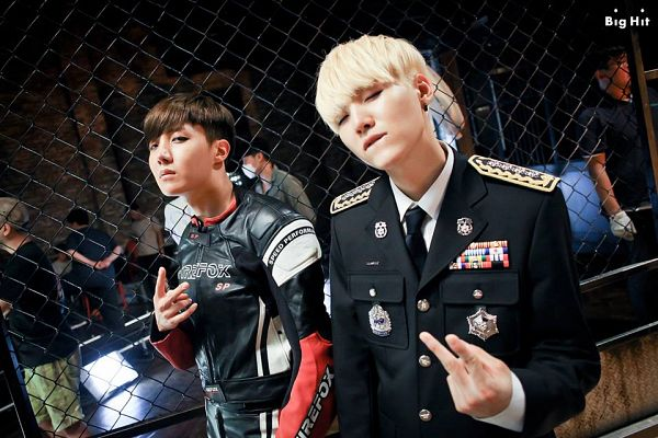 Tags: K-Pop, Bangtan Boys, DOPE, J-Hope, Suga, Two Males, Blonde Hair, Fence, Duo, V Gesture, Biting Lip, The Most Beautiful Moment in Life pt.1