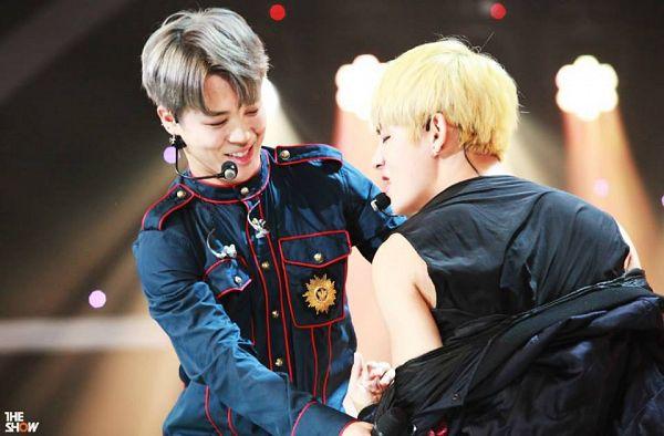Tags: Television Show, K-Pop, Bangtan Boys, V (Kim Taehyung), Park Jimin, Gray Hair, Looking At Another, Two Males, Black Shirt, Blonde Hair, Black Outerwear, Eyes Closed