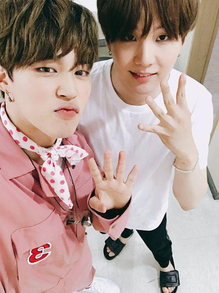 Tags: K-Pop, Bangtan Boys, Suga, Park Jimin, Bangs, Short Sleeves, Close Up, Pink Outfit, Jewelry, Black Footwear, Blunt Bangs, Holding Close