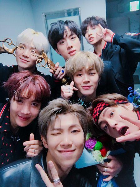 Tags: K-Pop, Bangtan Boys, Park Jimin, J-Hope, Suga, Jungkook, Jin, V (Kim Taehyung), Rap Monster, Blonde Hair, Heart Gesture, Black Eyes
