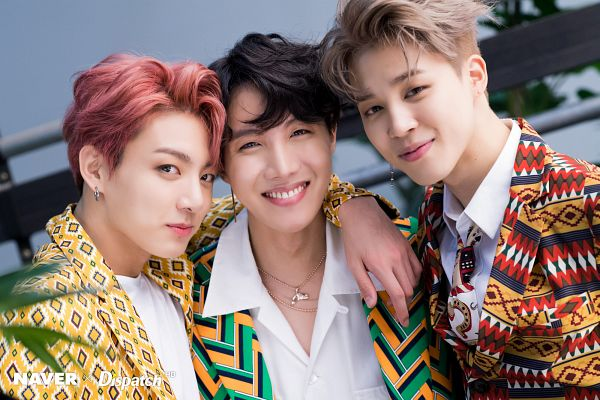 Tags: K-Pop, Bangtan Boys, J-Hope, Jungkook, Park Jimin, Arm Around Shoulder, Necklace, Close Up, Red Hair, Holding Close, English Text, Three Males