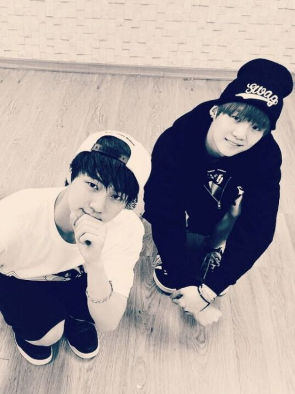 Tags: K-Pop, Bangtan Boys, Suga, Jin, Crouching, Hat, Two Males, Bracelet, Bent Knees, Grin, From Below, Duo