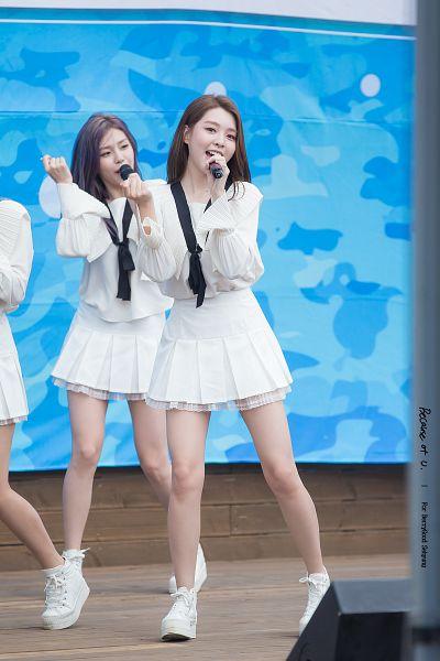 Tags: K-Pop, Berry Good, Kang Sehyung, Gowoon, Purple Hair, White Footwear, Skirt, Singing, White Skirt, Two Girls, Dancing, Duo