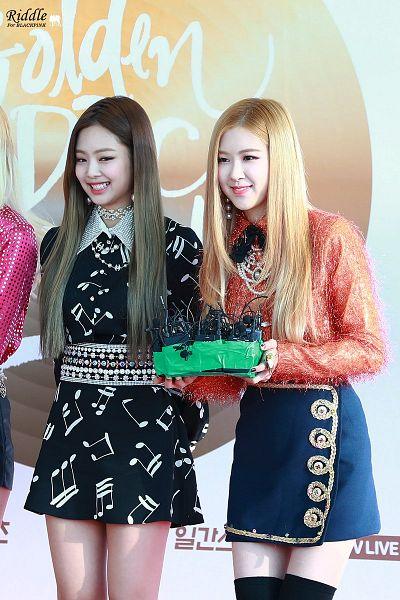 Tags: K-Pop, Black Pink, Jennie Kim, Rosé (singer), Two Girls, Black Dress, Black Bow, Duo, Looking Away, Sweater, Arms Behind Back, Belt