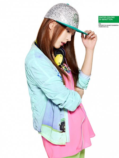 Tags: K-Pop, BoA, Blue Outerwear, Necklace, Looking Down, Crossed Arms, Green Pants, Hat, Hand On Hat, Light Background, Pink Shirt, White Background