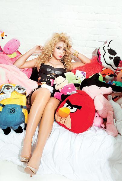 Tags: K-Pop, 2NE1, CL, Gray Background, Black Dress, Bracelet, Silver Footwear, Suggestive, Cleavage, Black Outfit, Wavy Hair, Stuffed Animal