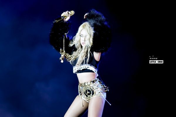 Tags: K-Pop, 2NE1, CL, Arms Up, Eyes Closed, Blue Background, Gray Shorts, Shorts, Messy Hair, Midriff, Live Performance