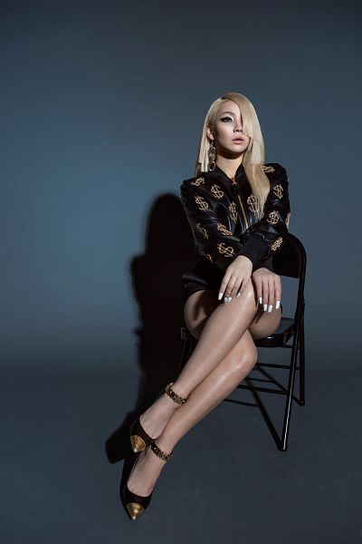 Tags: K-Pop, 2NE1, CL, Black Jacket, Bare Legs, Shorts, Looking Up, Full Body, Black Footwear, High Heels, Black Background, Sitting On Chair