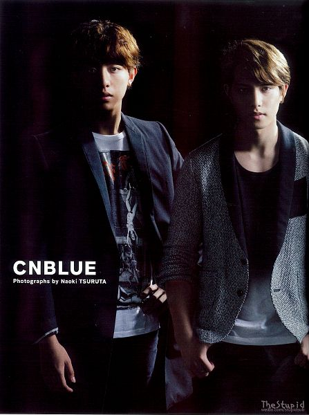 Tags: K-Pop, CNBLUE, Lee Jung-shin, Lee Jong-hyun, Text: Artist Name, Two Males, Black Pants, Gray Jacket, Dark Background, Black Jacket, Duo, Hand In Pocket
