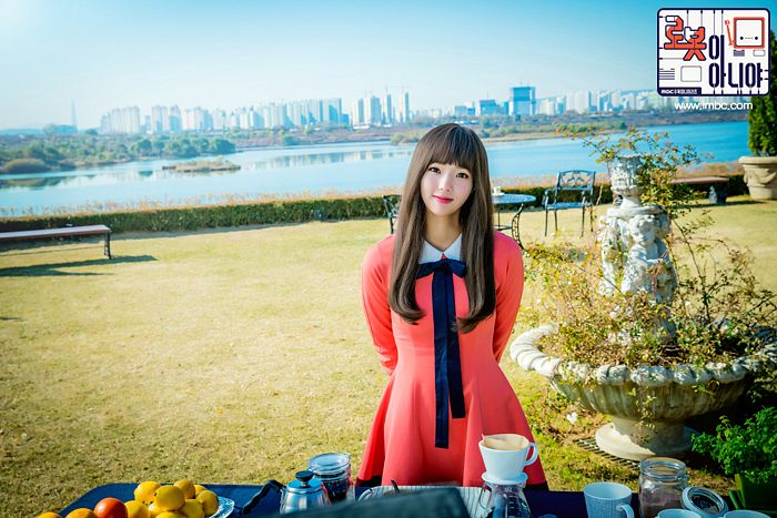 Tags: K-Drama, Chae Soo-bin, Pink Outfit, Arms Behind Back, Food, Pink Dress, River, Water, Text: Series Name, Korean Text, Grass, I'm Not a Robot