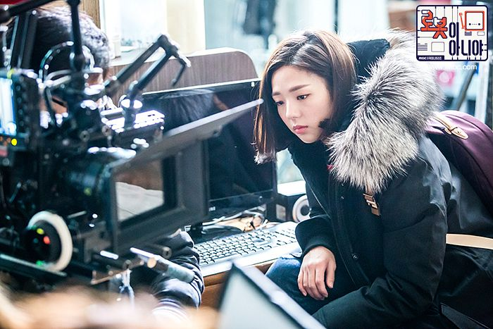 Tags: K-Drama, Chae Soo-bin, Medium Hair, Serious, Text: Series Name, Computer, Fur, Crouching, Fur Trim, Korean Text, I'm Not a Robot