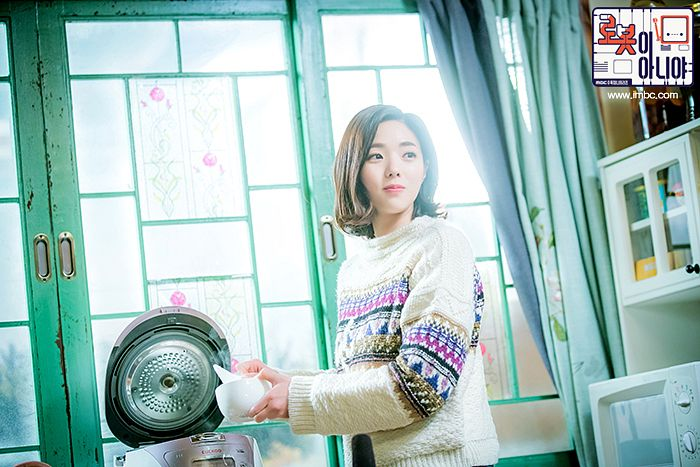 Tags: K-Drama, Chae Soo-bin, Korean Text, Text: Series Name, Window, Microwave, Curtain, Medium Hair, Kitchen, Sweater, I'm Not a Robot