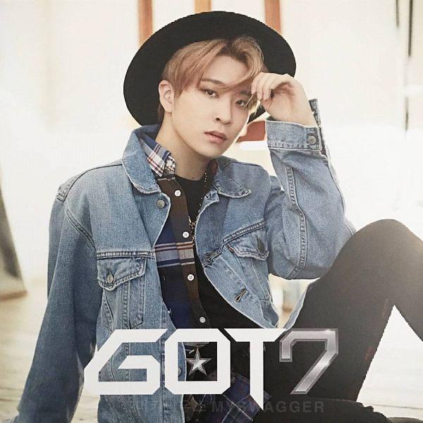 Tags: K-Pop, Got7, My Swagger, Choi Youngjae, Black Pants, Denim Jacket, Hat, Pants, Text: Artist Name, Blonde Hair, Serious, Sitting