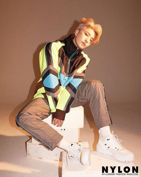 Tags: K-Pop, Got7, Choi Youngjae, Serious, Black Pants, Head Tilt, Brown Background, Magazine Scan, Nylon