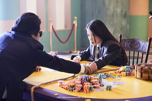 Tags: K-Drama, K-Pop, Coin (IU), Kim Yoon-seok, IU, Table, Sitting On Chair, Duo, Suit, Tie, Chair, Rope