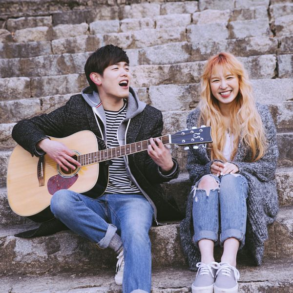 Tags: K-Pop, Red Velvet, Wendy, Eric Nam, Blunt Bangs, Musical Instrument, Gray Outerwear, Sitting On Stairs, Singing, Sneakers, Couple, Shoes