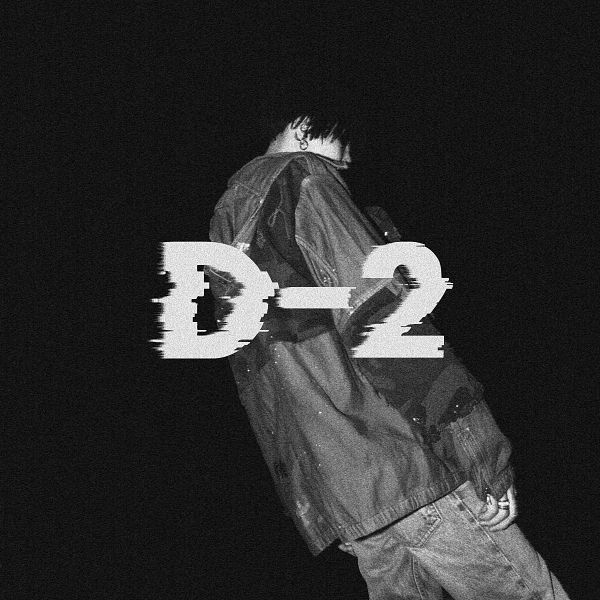Tags: K-Pop, BTS, Suga, Camouflage Print, Ring, Text: Album Name, Dark Background, Monochrome, Covering Mouth, Black Background, Jeans, Back