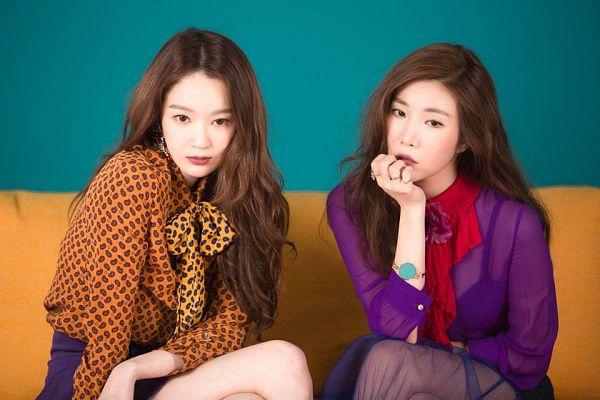 Tags: K-Pop, Davichi, Kang Minkyung, Lee Haeri, Skirt, Two Girls, Purple Skirt, Bare Legs, Duo, Sitting On Couch, Brown Shirt, Blue Background