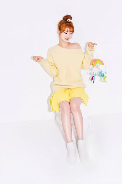 Tags: K-Pop, Berry Good, Because Of You, Daye, Red Hair, White Footwear, Looking Down, Light Background, Yellow Shirt, White Background, Shoes, Yellow Skirt