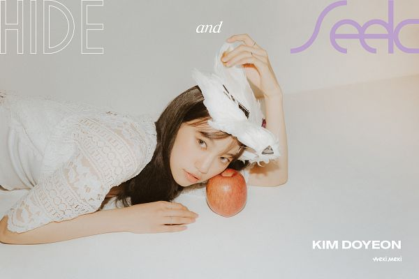 Tags: K-Pop, Weki Meki, Doyeon, Laying Down, Text: Album Name, Light Background, Hat, Hand On Hat, White Background, Laying On Ground, Apple, White Headwear