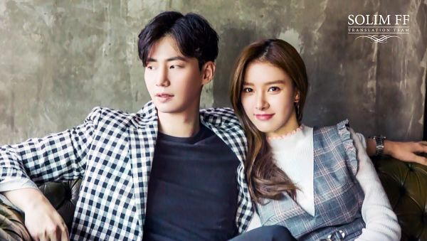 Tags: K-Drama, Kim So-eun, Song Jae-rim, Wristwatch, Checkered Jacket, Gray Dress, Sitting On Couch, Duo, Couch, Black Eyes, Arm Around Shoulder, Watch