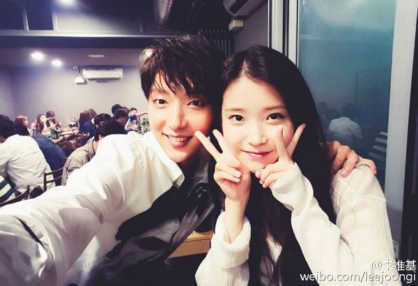 Tags: K-Drama, K-Pop, Lee Jun-ki, IU, Hand On Shoulder, Grin, Black Eyes, V Gesture, Arm Around Shoulder, Duo, Teeth