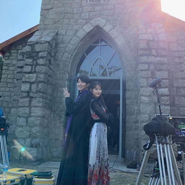 Tags: K-Pop, K-Drama, Lee Jun-ki, IU, Duo, Back To Back, Church, Crossed Arms, Scarf, V Gesture, Instagram, Hotel Del Luna