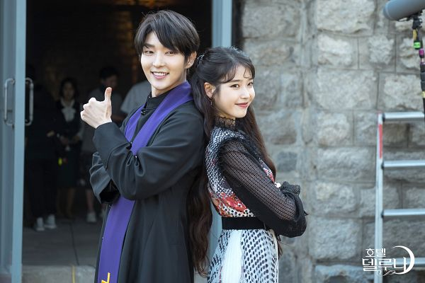 Tags: K-Drama, K-Pop, IU, Lee Jun-ki, Scarf, Ladder, Duo, Stairs, Text: Series Name, Thumbs Up, Korean Text, Crossed Arms