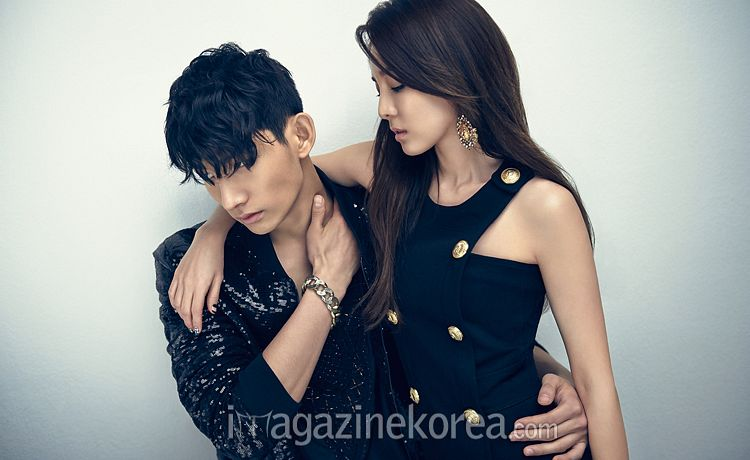 Tags: 2NE1, Hyeongseop, Sandara Park, Hand On Waist, Gray Background, Arm Around Shoulder, Black Outfit, Black Dress, Sitting On Lap, Duo, Magazine Scan, Scan