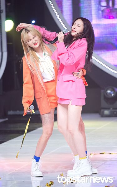 Tags: K-Pop, EXID, Le, Hani, Eyes Closed, Duo, Pink Outerwear, Arm Around Waist, Socks, Red Lips, Yellow Legwear, Full Body