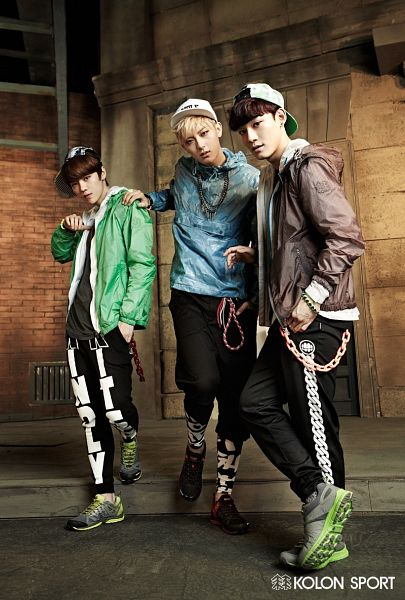 Tags: K-Pop, EXO, Luhan, Chen, Huang Zi Tao, Brown Outerwear, Coat, Hood, Brick Background, Three Males, Hat, Hoodie