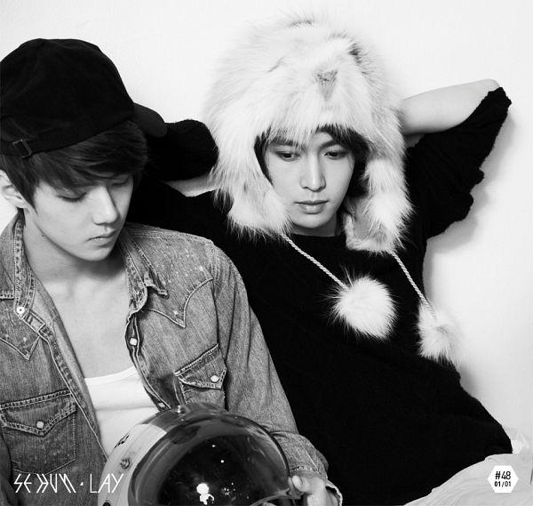 Tags: K-Pop, EXO, Lay, Sehun, Hand On Head, Light Background, White Headwear, Eyes Closed, Two Males, White Background, Denim Jacket, Monochrome