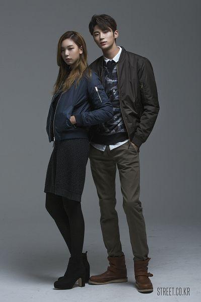 Tags: K-Drama, Byun Woo-seok, Lee Ho-jung, Duo, Gray Background, Hand In Pocket, High Heels, Serious, Skirt, Elvine
