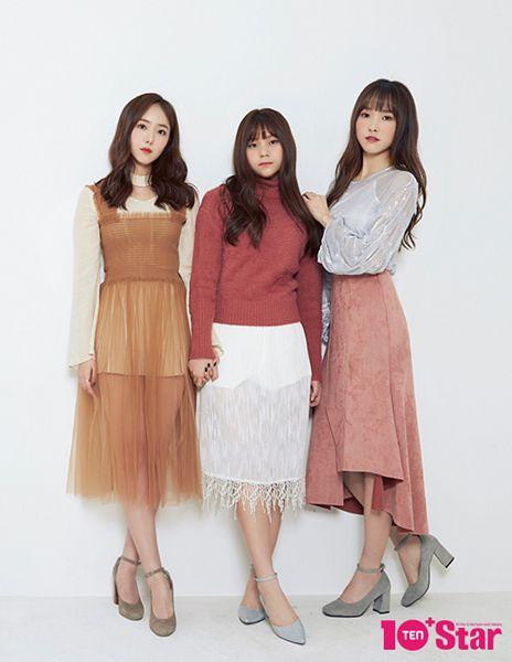 Tags: K-Pop, G-friend, Umji, Yuju, SinB, Pink Skirt, Holding Hands, Orange Outfit, High Heels, Red Shirt, Light Background, Three Girls