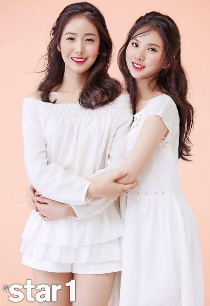 Tags: K-Pop, G-friend, SinB, Eunha, White Dress, Pink Background, Make Up, Sleeveless, Holding Close, Blush (Make Up), Bare Shoulders, Hug
