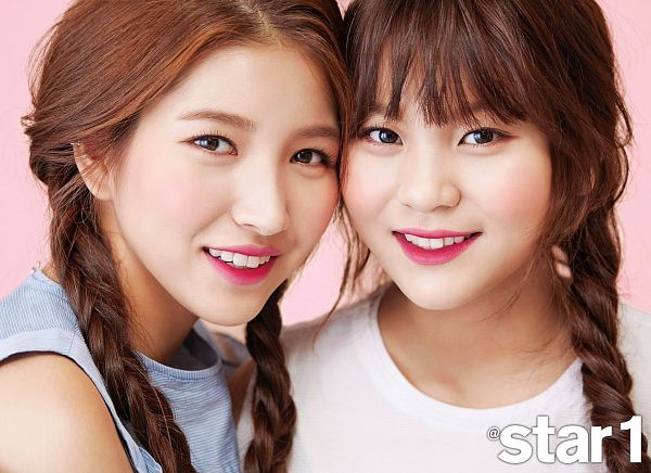 Tags: K-Pop, G-friend, Sowon, Umji, Single Braid, Duo, Pink Background, Blue Shirt, Braids, Two Girls, Twin Braids, Star1