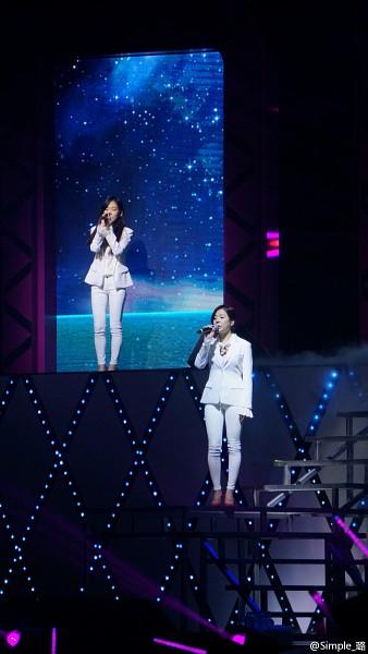 Tags: K-Pop, Girls' Generation, Sunny, Kim Tae-yeon, High Heels, Two Girls, Eyes Closed, Singing, Microphone, Duo, Red Footwear, White Jacket