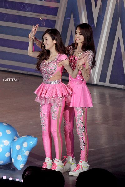 Tags: SM Town, K-Pop, Girls' Generation, Im Yoona, Jessica Jung, Pink Pants, Pink Skirt, Pink Outfit, Two Girls, Holding Hands, Silver Footwear, Skirt