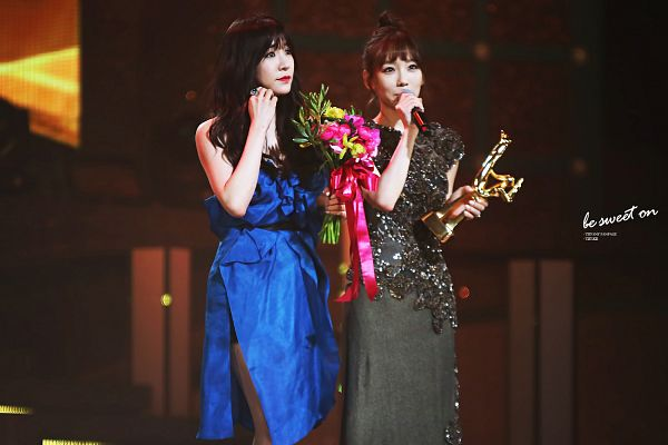 Tags: SM Town, K-Pop, Girls' Generation, Stephanie Young Hwang, Kim Tae-yeon, Looking Away, Two Girls, Hair Up, Hand In Hair, Bare Legs, Duo, Bouquet
