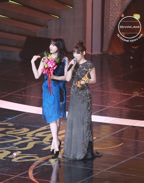 Tags: SM Town, K-Pop, Girls' Generation, Stephanie Young Hwang, Kim Tae-yeon, High Heels, Duo, Black Dress, Black Shorts, Crossed Legs (Standing), Blue Dress, Covering Mouth