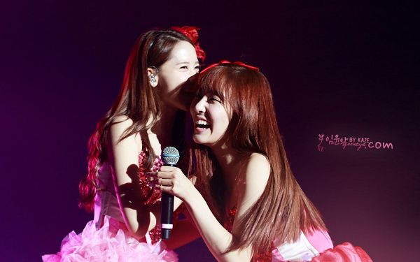 Tags: K-Pop, Girls' Generation, Im Yoona, Stephanie Young Hwang, Bare Shoulders, Purple Background, Sleeveless Dress, Pink Outfit, Laughing, Looking Ahead, Pink Dress, Two Girls